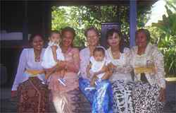 Robbi with 3 generations of women from the lovely family owned hotel that we stay at during the Bali Women's Retreat