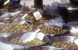 Olive stand in a colourful market - who can resist a little taste