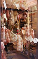 Salamis and other preserved meats tantalize the passer-by