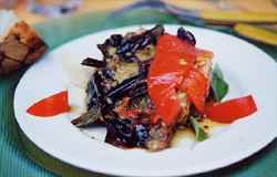 Roasted aubergine and red peppers with fine olive oil and herbs.